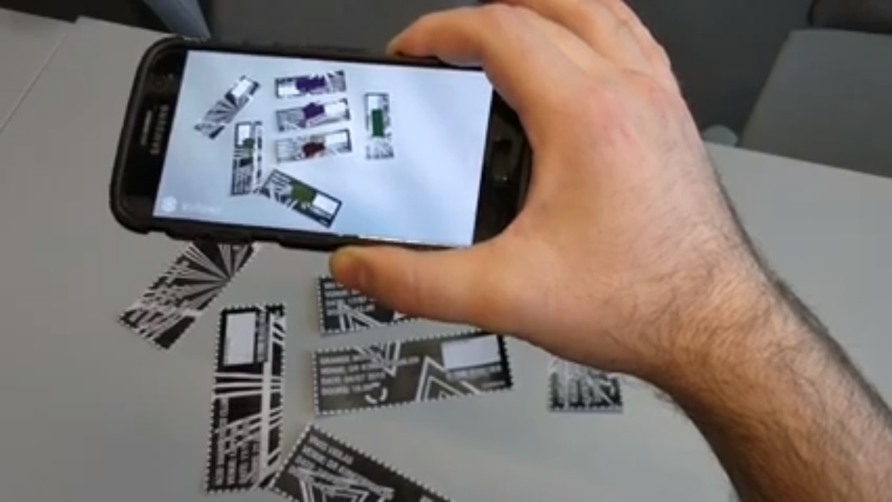 Playing Tickets in action: When the phone recognizes a ticket, it shows an instrument superimposed on the ticket and plays an associated audio track.